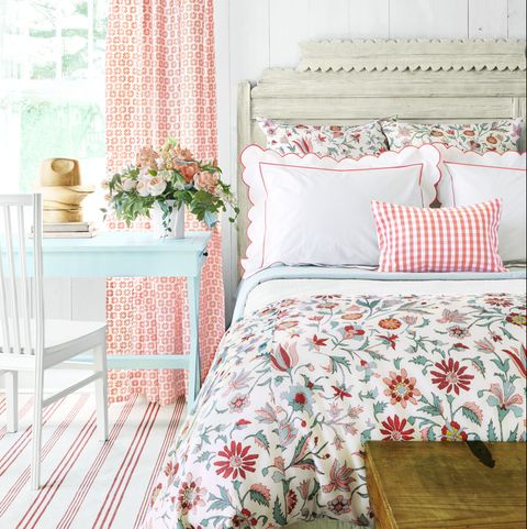 a bedroom with spring like colors that shows a bed and desk and chair and window