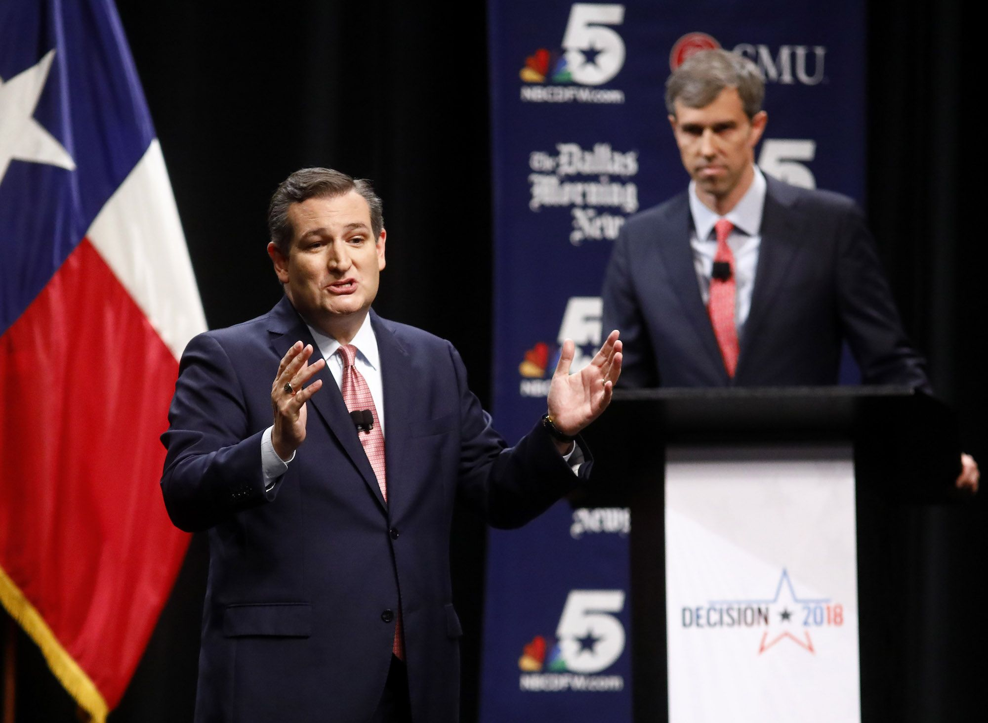 Beto looks on as Ted Cruz dispenses some of his trademark charm at a Senate debate last September.