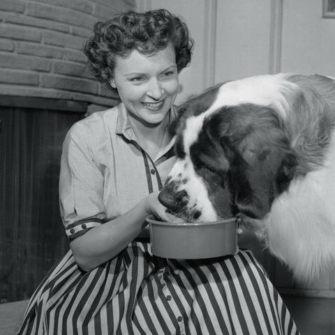 Betty White Feeding Her Dog