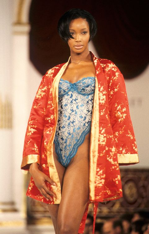 beverly peele wearing a blue bodysuit and orange kimono at the victoria's secret fashion show in 1995