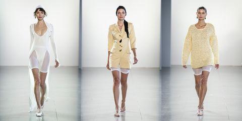 Fashion model, Clothing, Fashion, Runway, Fashion show, Shoulder, Dress, Fashion design, Beige, Haute couture,