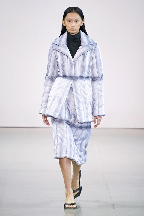 Fashion model, Fashion show, Fashion, Runway, Clothing, White, Outerwear, Public event, Fashion design, Human,