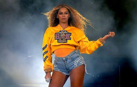 Yellow, Clothing, Fashion model, Thigh, Fashion, Performance, Leg, Jeans, Photography, Long hair,