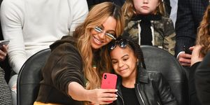 Beyonce and Blue Ivy sat courtside