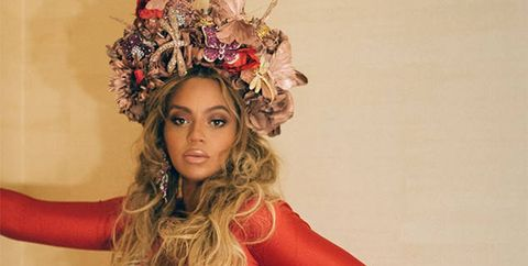 Beyonce wearing a flower crown to the wearable art gala