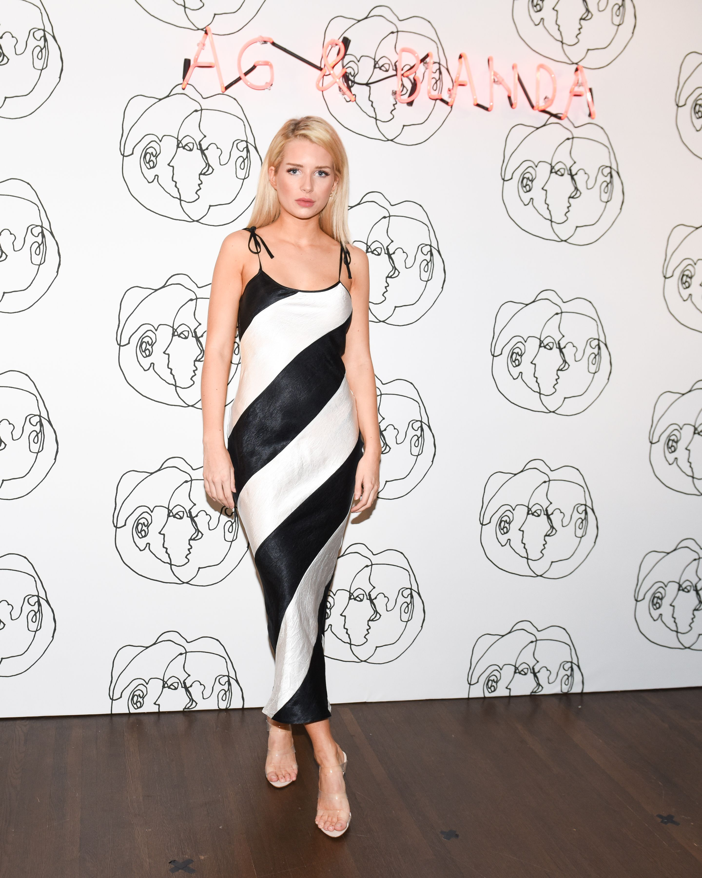 Lottie Moss Lottie Moss at the launch of AG's exclusive capsule collection with multimedia artist Blanda, co-hosted by Emily Ratajkowski to coincide with World Water Day, on March 21.