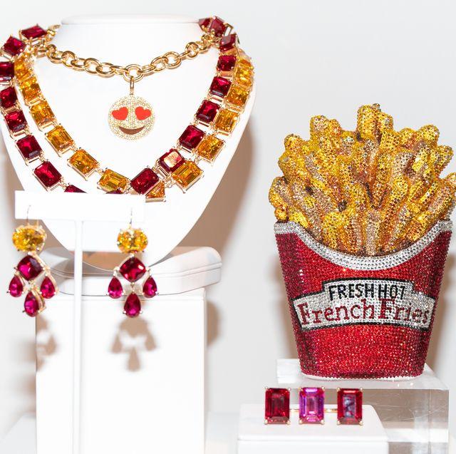 Fashion accessory, Jewellery, Popcorn, Snack, Font, Gemstone, Vegetarian food, Food, Pendant, Necklace,
