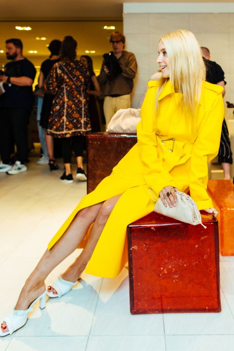 Yellow, Fashion, Orange, Footwear, Human leg, Outerwear, Leg, Street fashion, Fashion design, Event,