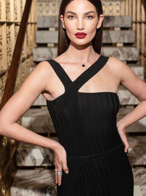 Fashion model, Clothing, Fashion, Dress, Beauty, Shoulder, Little black dress, Cocktail dress, Model, Haute couture,