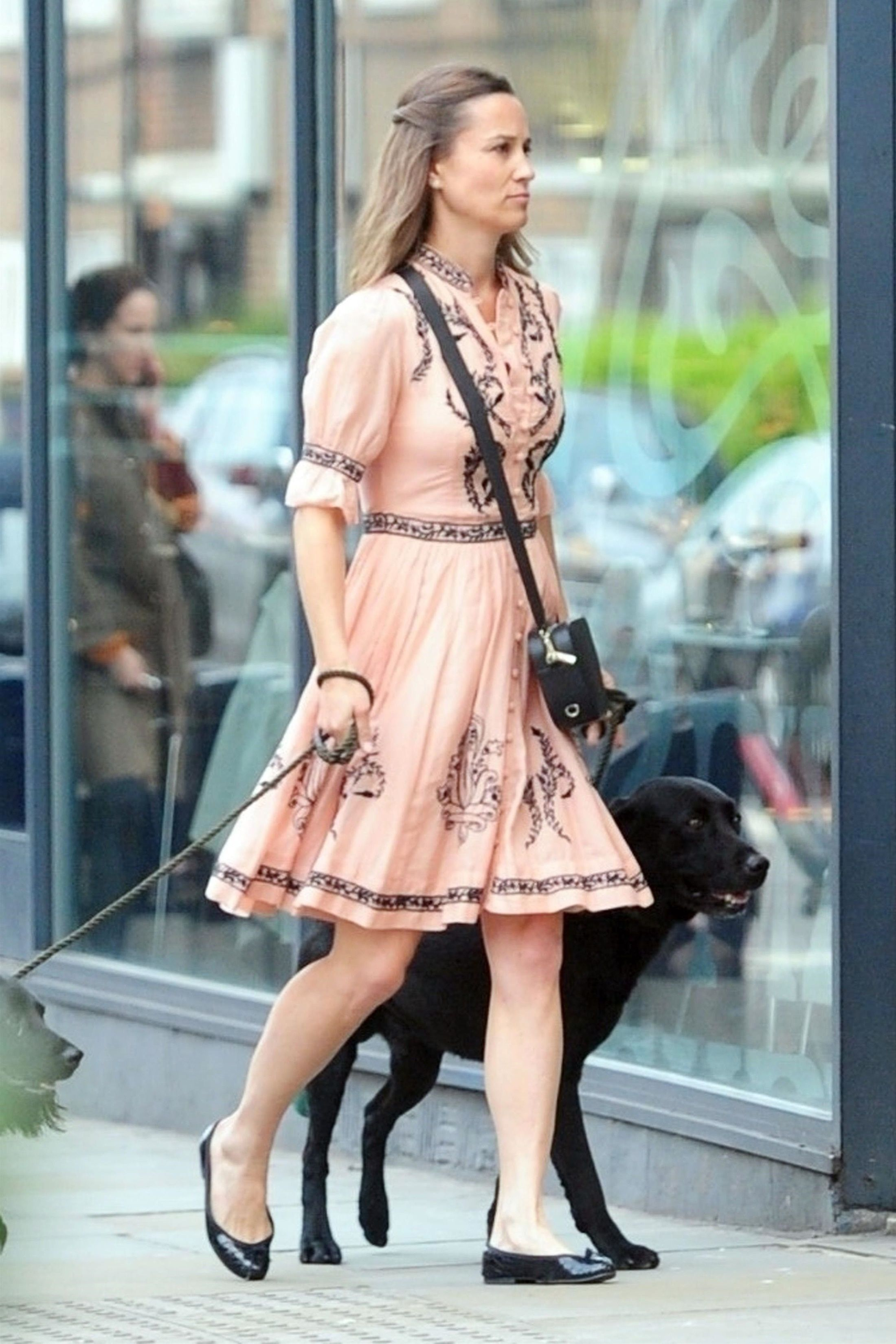 Pippa wore her Pop and Suki black camera bag with a bohemian pink minidress and black flats while walking her dogs in the Chelsea neighborhood of London, England.