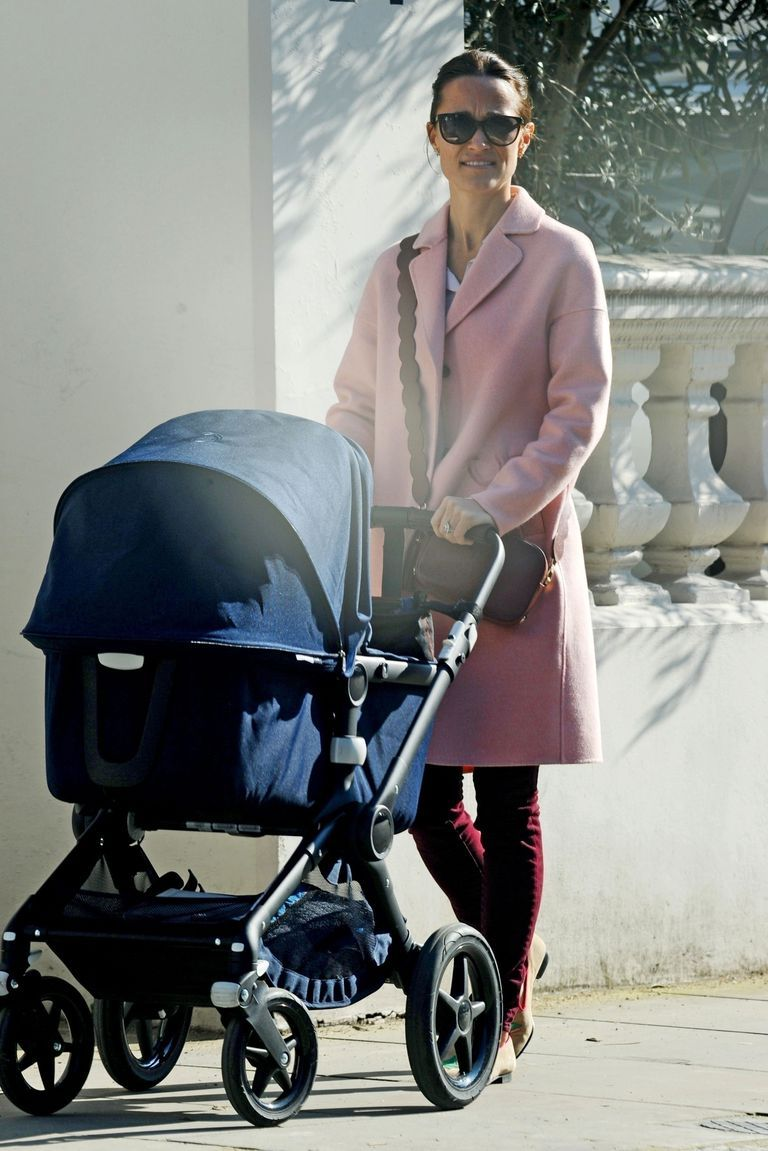 Pippa enjoyed a walk with her nanny as she took her baby, Arthur, out on a sunny day in London. She wore a pink Claudie Pierlot coat, burgundy skinny jeans, and her favorite Pop and Suki bag with the interchangeable scallop straps.