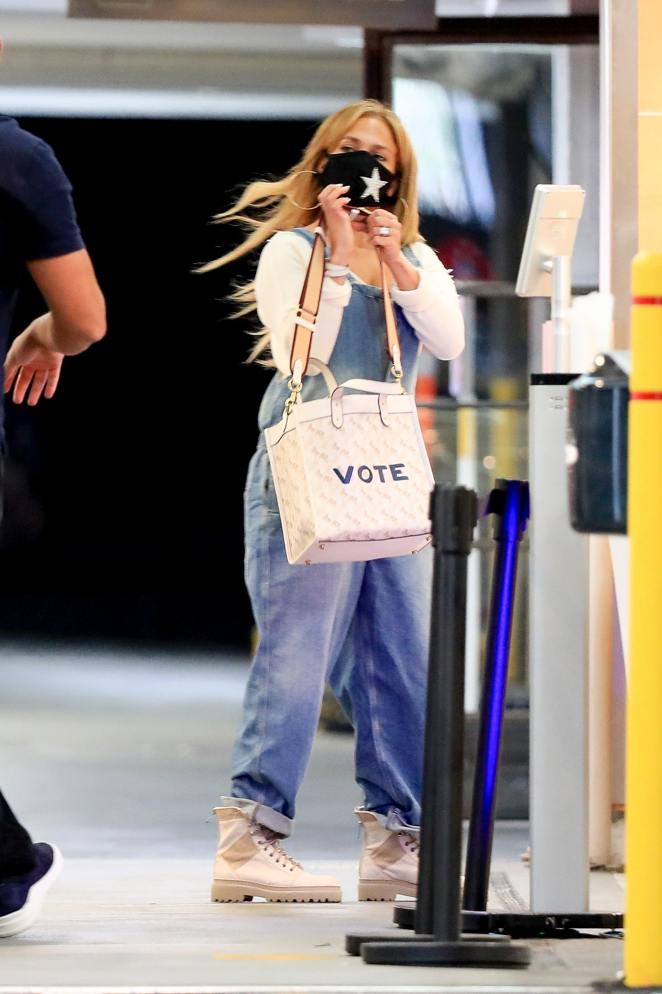 Jennifer Lopez Steps Out In Combat Boots And A Coach Vote Bag