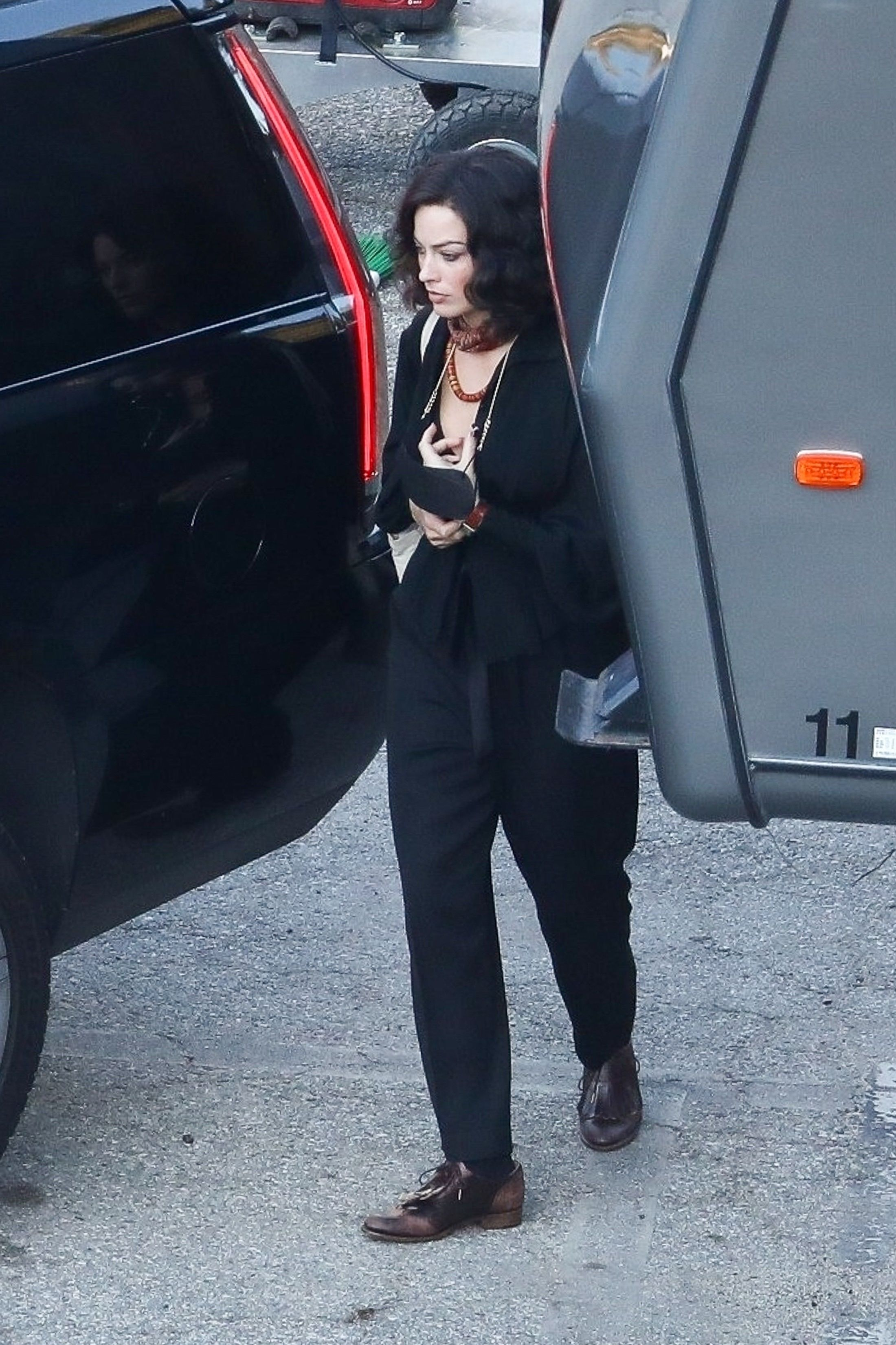 Margot Robbie Transforms in Black Wig for David O. Russell Film