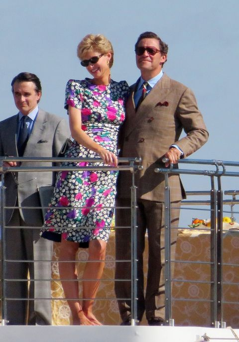 actors elizabeth debicki and dominic west looking identical to princess diana and prince charles while on a yacht while filming the crown season 5
