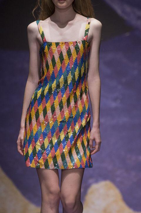 Fashion model, Clothing, Fashion, Dress, Fashion show, Yellow, Fashion design, Runway, Footwear, Day dress,