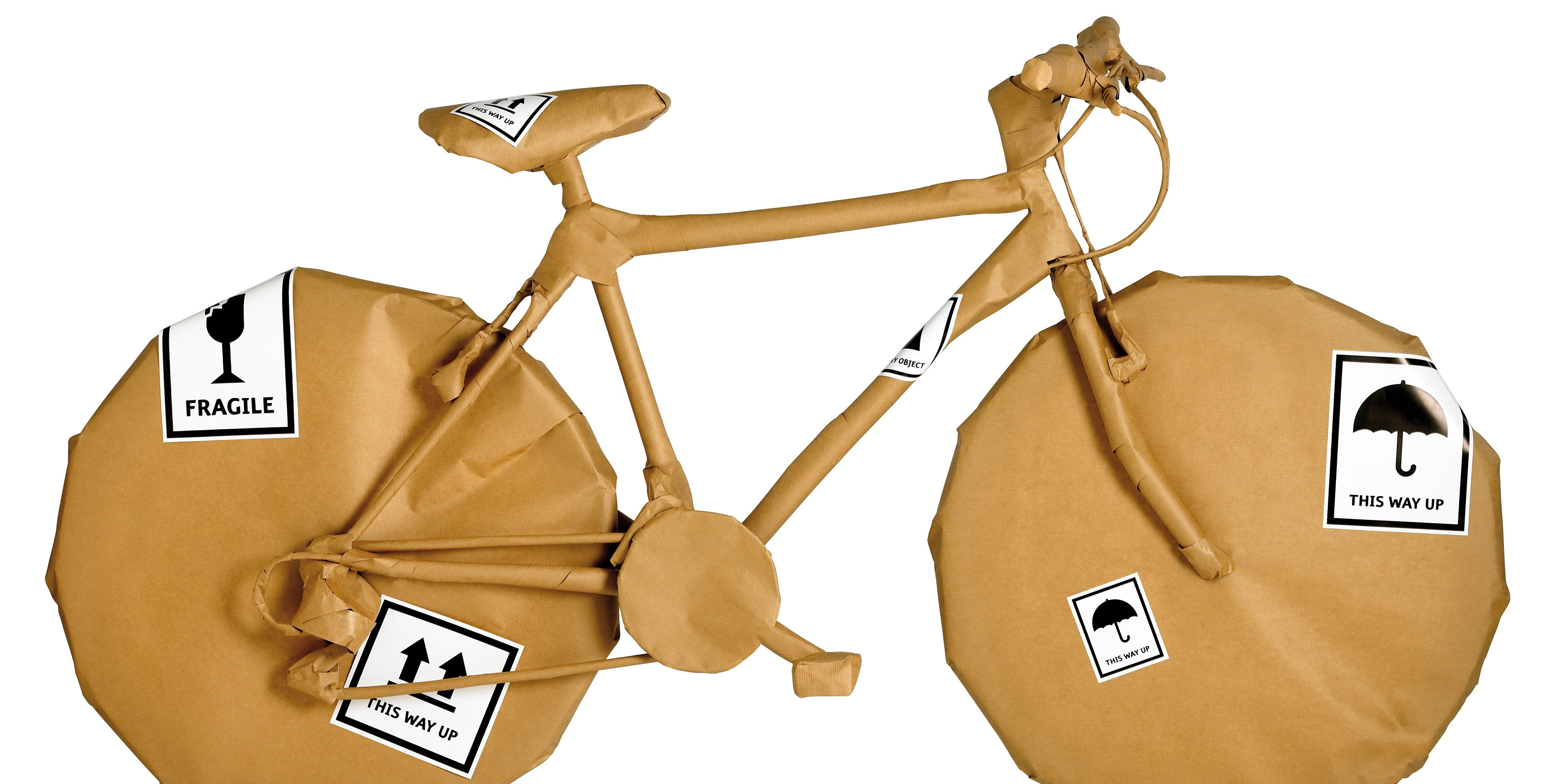 bicycle  wrapped in brown paper isolated on white