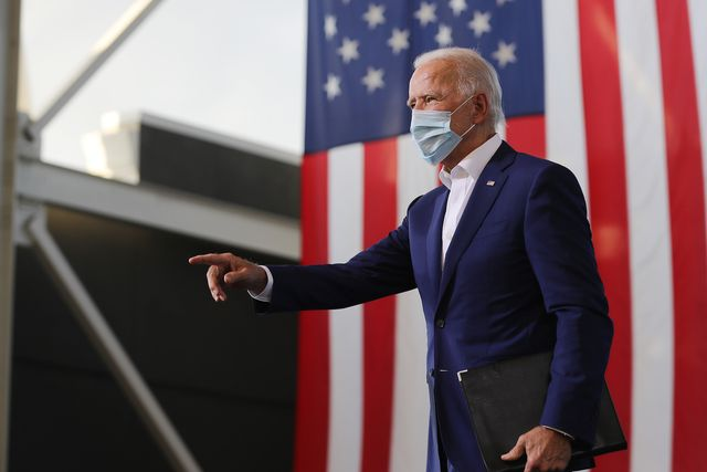 miramar, florida   october 13 wearing a face mask to reduce the risk posed by the coronavirus, democratic presidential nominee joe biden points to supporters during a drive in voter mobilization event at miramar regional park october 13, 2020 in miramar, florida with three weeks until election day, biden is campaigning in florida photo by chip somodevillagetty images