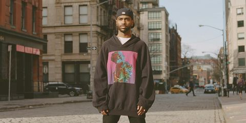 Trousers, Neighbourhood, Street, Town, Building, Jacket, Street fashion, Urban area, Sidewalk, Pedestrian,