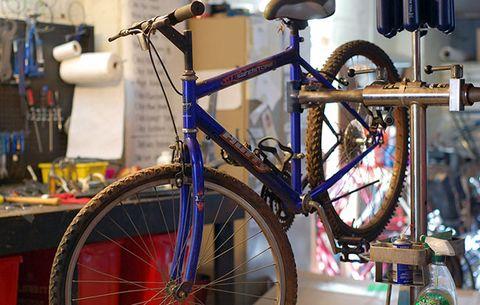 A bike in a repair stand.