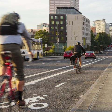 cyclists in a bike lane heading into downtown portland, oregon