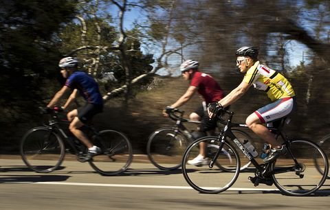 cyclists riding
