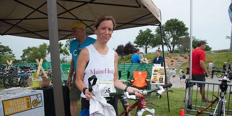 Runner and bike at 2014 Beach to Beacon 10K