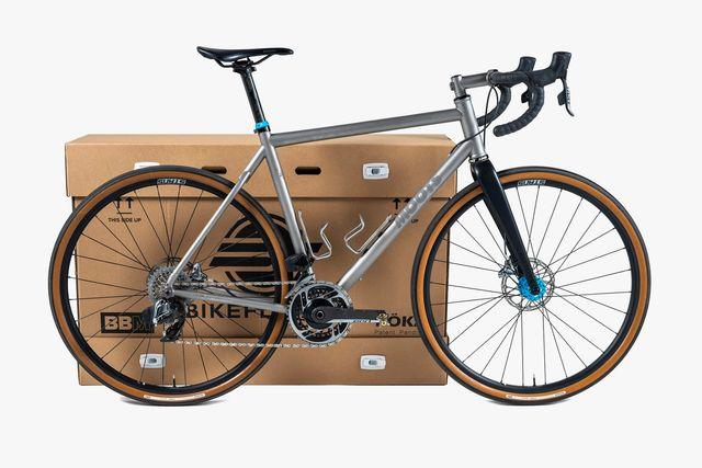 a bike next to a big cardboard box