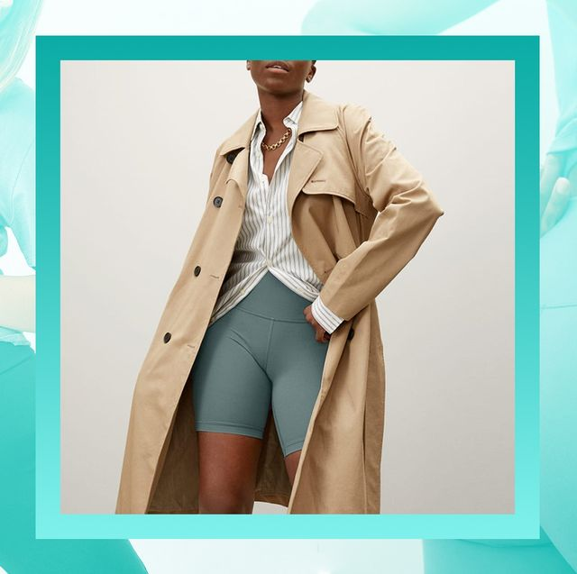 woman in biker shorts and trench coat