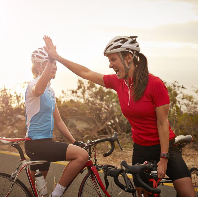 bikeriders  training partners doing high five