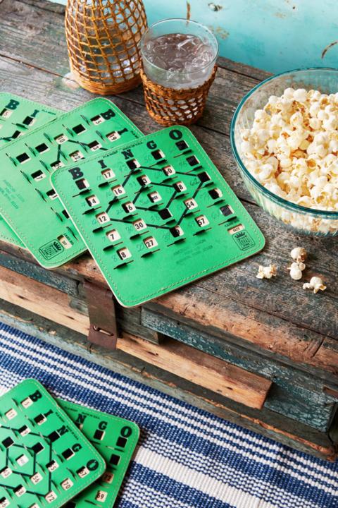 vintage bingo game cards beside a bowl of popcorn