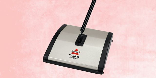 bissell carpet sweeper with pink, textured background