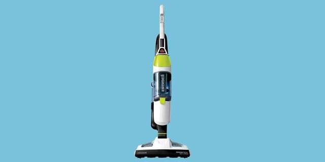 green and white bissell vacuum and steam mop hybrid with light blue background