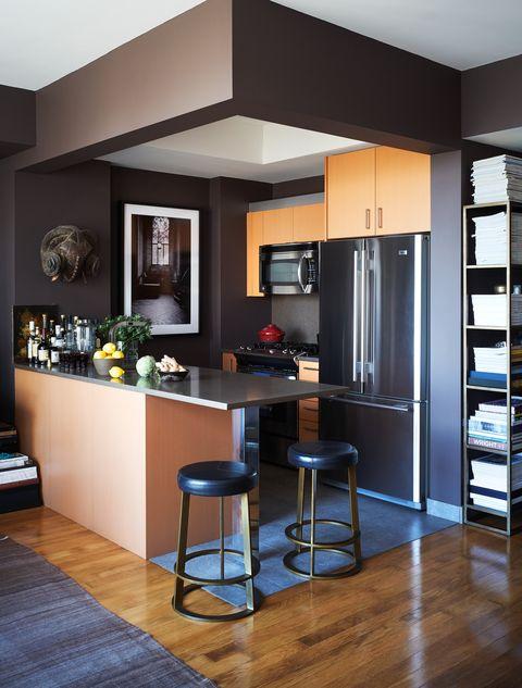 modern, minimal corner kitchen in dark colors