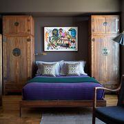 dark moody bedroom with purple bedspread