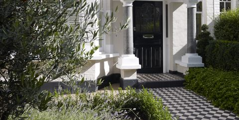 Black And White Chequered Path Up To Romanesque Arched Front Doorway