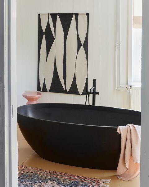black freestanding bathtub, abode living, abstract black and white wall hanging