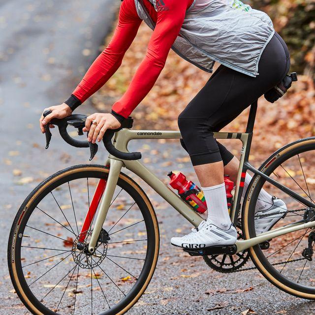 man riding a road bike closeup of foot