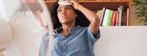 Black girl feeling bad for summer heat haze