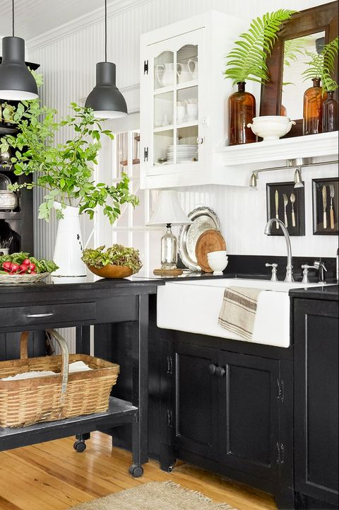 black kitchen cabinets - black island hardwood floors