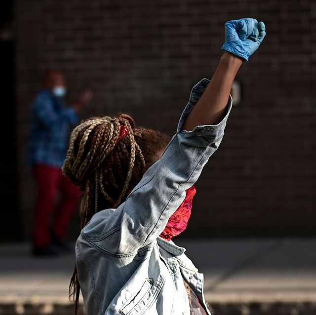 a woman raises her fist on june 1, 2020, during a black lives matter protest in east village of new york city   new yorks mayor bill de blasio today declared a city curfew from 1100 pm to 500 am, as sometimes violent anti racism protests roil communities nationwide saying that we support peaceful protest, de blasio tweeted he had made the decision in consultation with the states governor andrew cuomo, following the lead of many large us cities that instituted curfews in a bid to clamp down on violence and looting photo by johannes eisele  afp photo by johannes eiseleafp via getty images