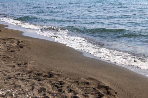 Black magnetic sand beach of Black sea in Ureki, Georgia
