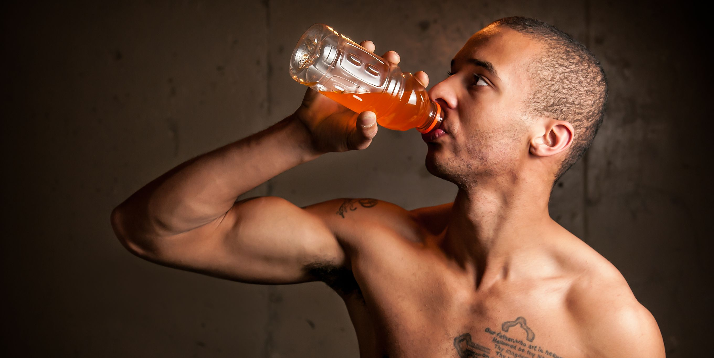 Black male drinking a sports drink