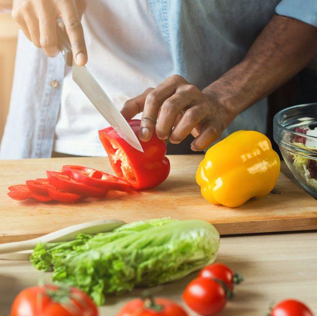 black man preparing vegetable salad