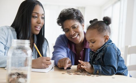 Black multi-generation family counting coins