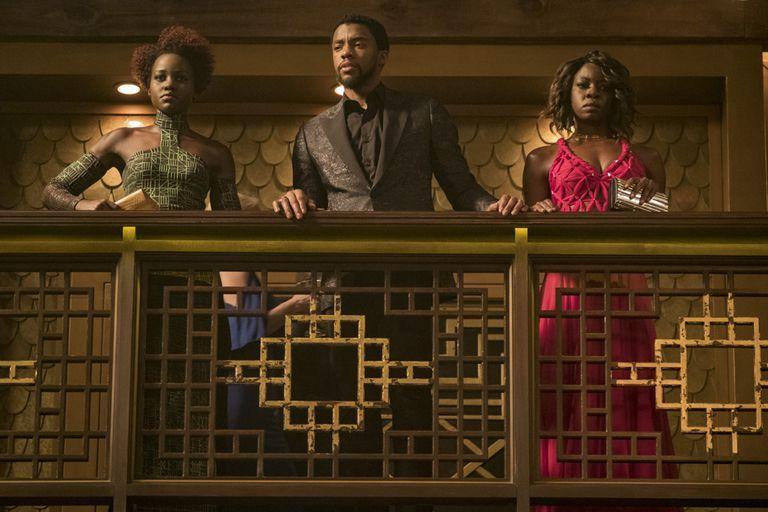 Black Panther Nakia (Lupita Nyong'o), T'Challa (Chadwick Boseman), and Okoye (Danai Gurira)