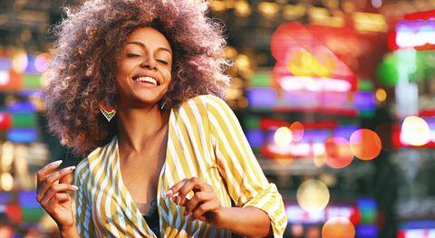 Black woman dancing at a concert.