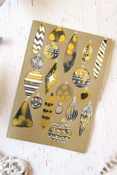 gold and black ornaments on paper