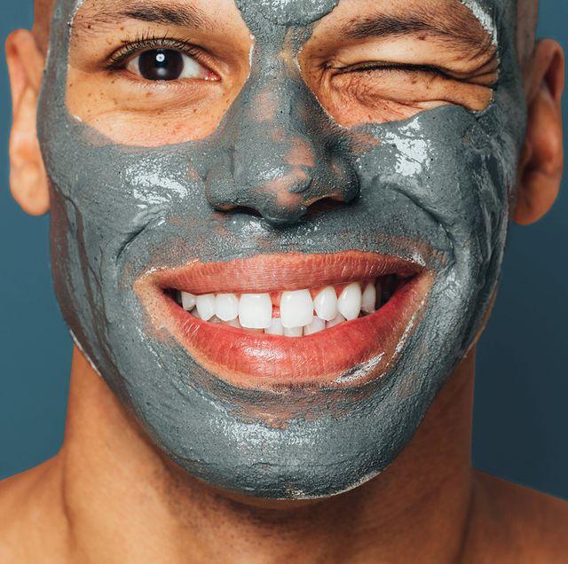 man wearing mud mask