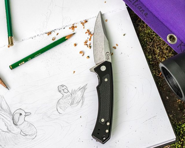 a knife on a piece of paper