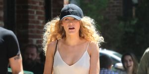Blake Lively slip dress baseball cap no bra